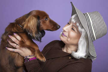 Middle-aged woman holding a dog