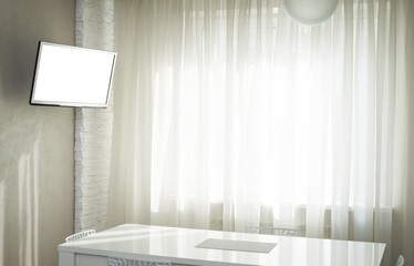 Flat panel LCD TV in a white kitchen interior, clipping path