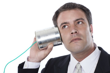 businessman and tin can phone