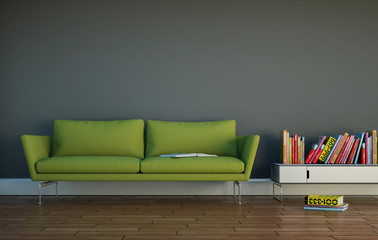 grünes Sofa vor grauer Wand