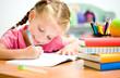little girl is writing