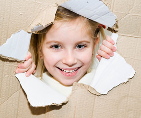 kid in torn paper hole