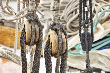 Vintage wooden pulley block in an ancient boat
