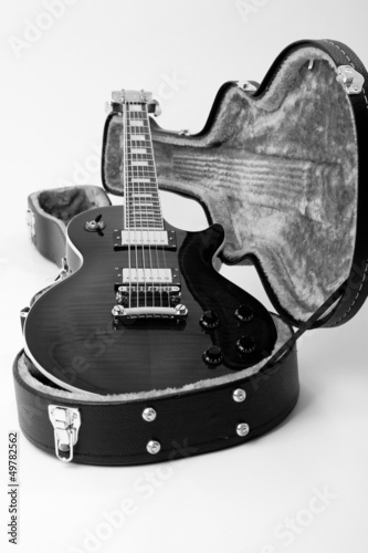 Guitar in open case isolated on the white background