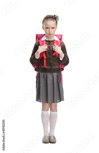 Frowning pupil is ready to go to school, isolated Poster