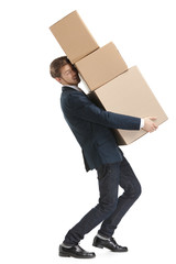 Shop assistant carries the parcel consisting of three boxes