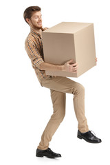 Deliveryman hardly carries the parcel, isolated