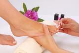 Fototapety Beauty treatment photo of nice pedicured feet