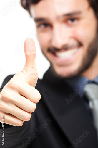 Businessman doing ok sign isolated on white