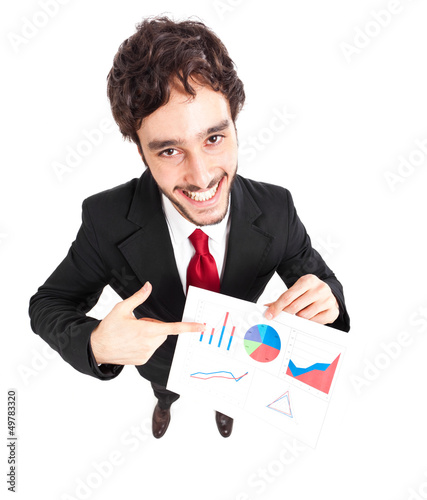 Smiling young businessman showing a business plan