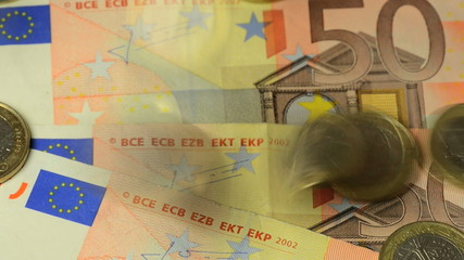euro coins dropping on 50 euro note