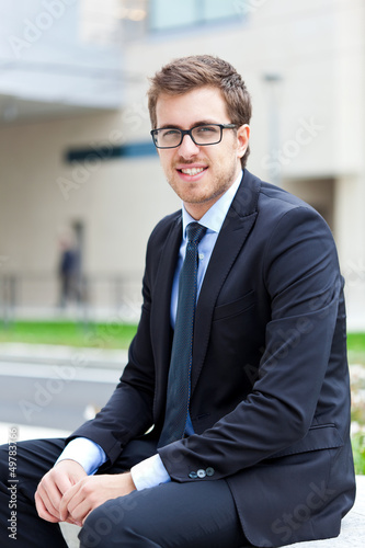 Businessman sitting outdoor