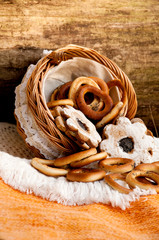 Bagels and cookies scattered from wicker basket