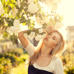 beautiful girl in a summer park. sensual pictures in warm colors