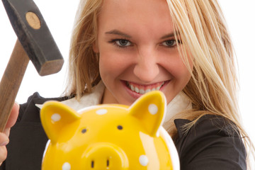 Young woman smashing piggy bank closeup