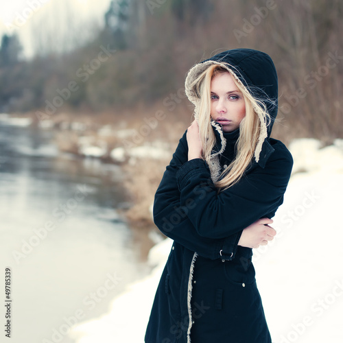 beautiful lonely girl sad winter near water