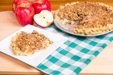 Slice of apple crumb top pie