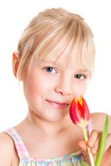 kleines Mädchen mit Tulpe