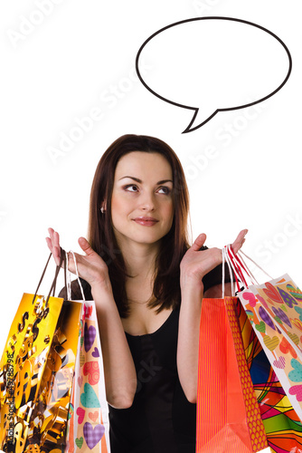 Woman with shopping bags thinking/dreaming about something