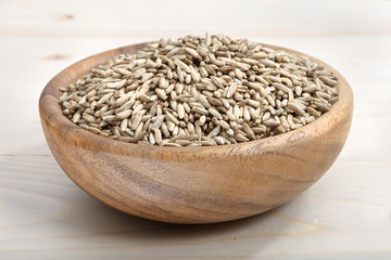 a bowl of oat on wooden surface