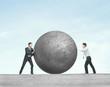 two man pushing ball
