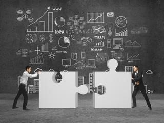 two businessman puts puzzle