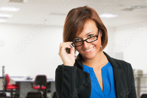 Smiling woman holding her eyeglasses
