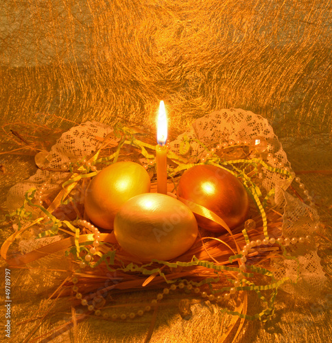 Golden Easter egg with candle