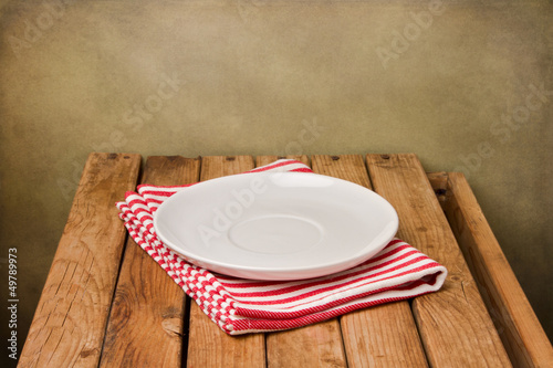 Background with empty plate and wooden table - 49789973