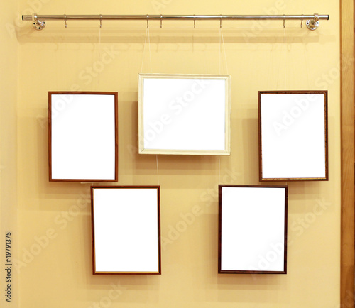 Five frames with isolated canvas on the exhibition ledge