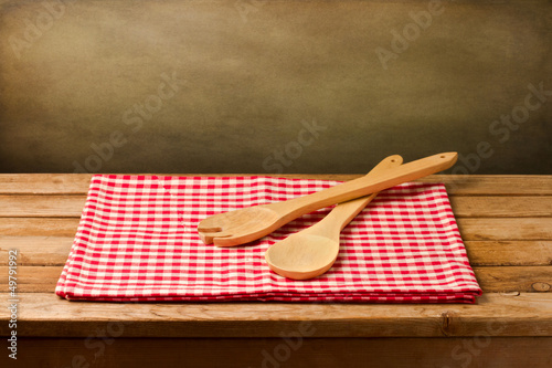 Background with kitchen utensils on tablecloth