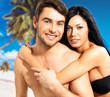 Happy beautiful couple in love  at tropical beach