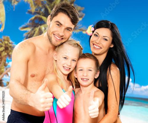 Happy smiling family with thumbs up sign