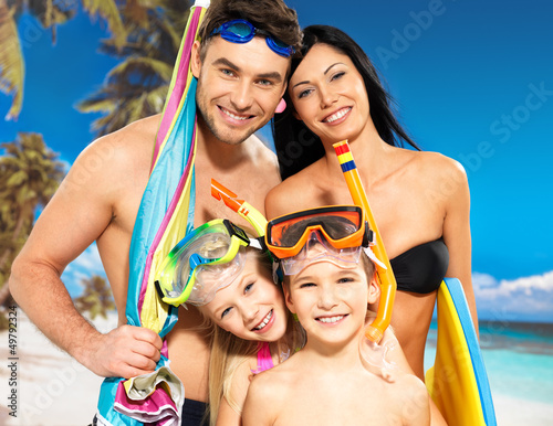 Happy fun family with two children at tropical beach