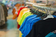 Bright color t-shirts on stands in kids store