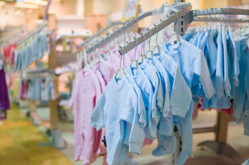 Body clothes for newborn babies on stands in kids store