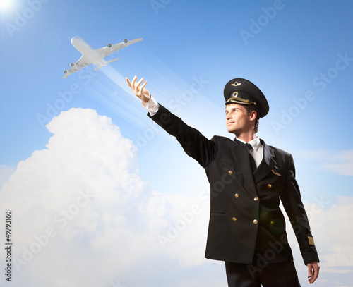 Image of pilot touching air