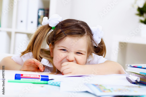 Little girl and her mother studying