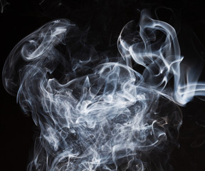 Blue smoke on black background