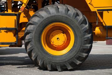 big wheel on yellow tractor