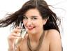 junge Frau mit Sektglas