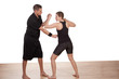 Instructor teaching a woman kick boxing