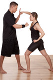 Woman and man practising kick boxing