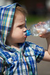 Little boy drinking from plastic bottle