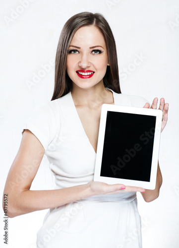 beautiful woman holding tablet pc