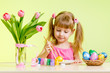 cute kid girl painting Easter eggs