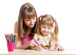 mother and her child girl pencil together