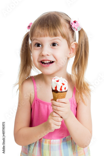 happy child girl eating ice cream in studio isolated