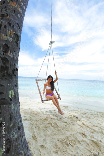 Womain in beach hammock