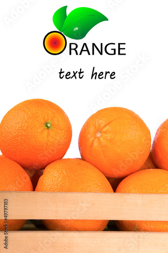 Fresh and ripe orange fruits in a wooden crate isolated on white
